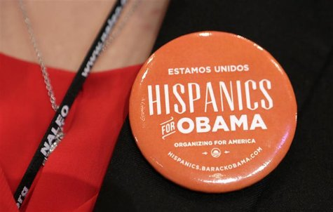 "A woman wears a pin which says ""Hispanics for Obama"" before U.S. President Barack Obama spoke at the National Association of Latino Elected"