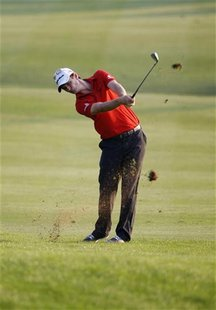 Justin Rose of England hits a shot at the 18th hole during the first round of the DP World Tour Championship at Jumeirah Golf Estates in Dub