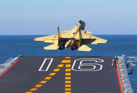 A carrier-borne J-15 fighter jet takes off from the Liaoning, China's first aircraft carrier, in this undated handout photo released Novembe
