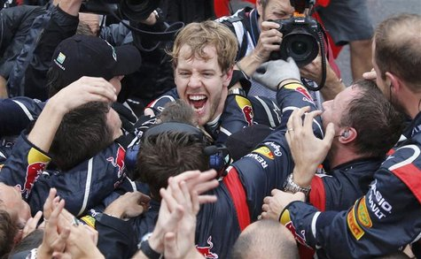 Red Bull Formula One driver Sebastian Vettel of Germany celebrates winning the world championship with his team after finishing sixth in the