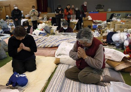Victims of the March 11 earthquake and tsunami observe a minute of silence at a shelter in Kamaishi, Iwate prefecture, in this April 11, 201