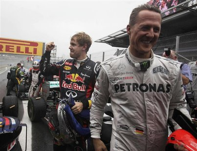 Red Bull Formula One driver Sebastian Vettel of Germany (L) celebrates winning the world championship next to compatriot Mercedes driver Mic