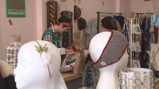 A shopper picks up holiday gifts at Dainty Daisies in Appleton on Small Business Saturday, November 24, 2012. (courtesy of FOX 11)