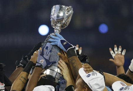 The Grey Cup is hoisted by the Toronto Argonauts after they defeated the Calgary Stampeders in the 100th CFL Grey Cup championship football