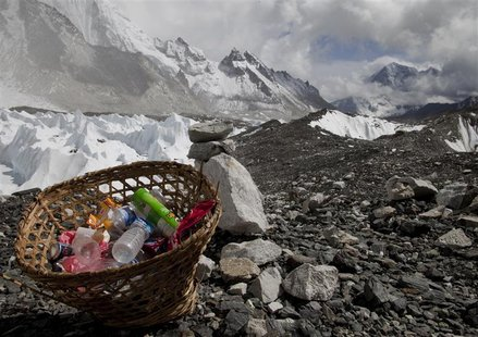 Rubbish collected at Everest base camp with the Himalayan range seen at the background in Nepal, May 03, 2011. Picture taken May 03, 2011. R