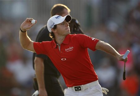 Rory McIlroy of Northern Ireland celebrates at the 18th green after the fourth and final round of the DP World Tour Championship at Jumeirah
