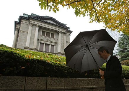 A man walks past the Bank of Japan (BOJ) headquarters in Tokyo November 26, 2012. Bank of Japan Governor Masaaki Shirakawa urged the governm