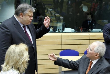 Greece's Finance Minister Evangelos Venizelos (L) talks with Germany's Finance Minister Wolfgang Schaeuble at the start of a Eurogroup meeti