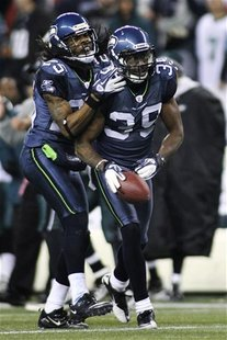 Seattle Seahawks cornerback Brandon Browner (39) is congratulated by teammate Richard Sherman (L) after Browner intercepted a pass intended