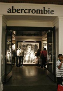 A boy stands at the entrance of an Abercrombie & Fitch store at the Glendale Galleria mall in this November 28, 2008 file photo. REUTERS/Fre