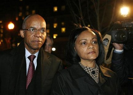 U.S. former Rep. William Jefferson (D-La) walks with his wife, Dr. Andrea Green Jefferson after his sentencing at the U.S. District Court fo