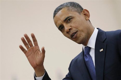 U.S. President Barack Obama waves as he leaves the 21st ASEAN (Association of Southeast Asian Nations) and East Asia summit in Phnom Penh No