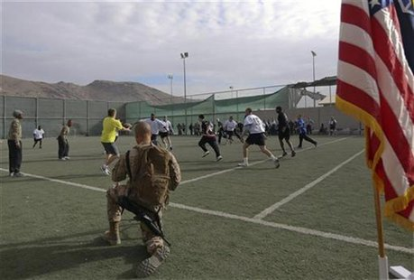 U.S. troops play touch football in the early morning hours on Thanksgiving at a military base in Kabul, November 22, 2012. REUTERS/Omar Sobh