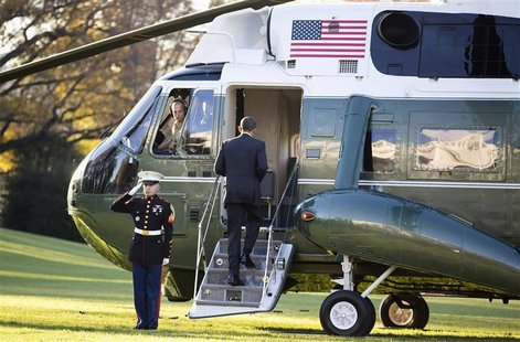U.S. President Barack Obama boards Marine One before departing for a trip to Thailand, Burma and Cambodia from the White House in Washington