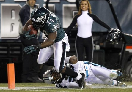 Philadelphia Eagles running back Bryce Brown (34) scores a touchdown as the Carolina Panthers cornerback Josh Norman (24) tries to make the