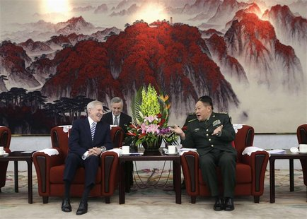 United States Secretary of the Navy Ray Mabus (L) talks with China's Defense Minister Liang Guanglie during a meeting at the Bayi Building,