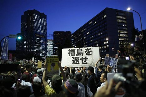 Protesters take part in an anti-nuclear demonstration demanding a stop to the resumption of nuclear power operations, in front of Japanese P