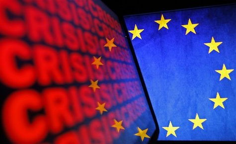 The logo of the European Union and the word recession are displayed on the screen an iPad and a LCD monitor in Zenica November 16, 2012. REU