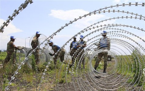 The South Africa contingent of the U.N. peacekeepers in Congo erect a razor wire barrier around Goma airport in the Democratic Republic of C