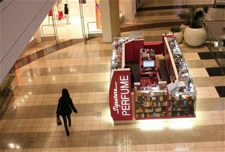 A woman walks through a shopping mall in San Francisco, California January 5, 2012. REUTERS/Robert Galbraith