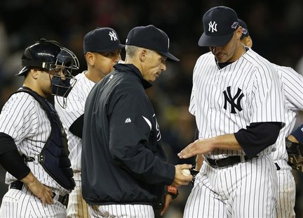 New York Yankees starting pitcher Andy Pettitte (R) is relieved by manager Joe Girardi as catcher Russell Martin (L) and third baseman Alex