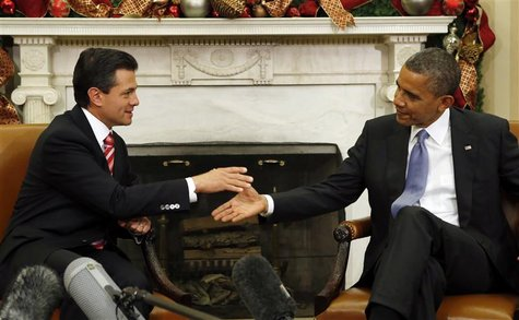 U.S. President Barack Obama (R) meets with Mexico's President-elect Enrique Pena Nieto in the Oval Office of the White House in Washington N