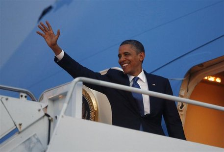 U.S. President Barack Obama waves from Air FOrce One as he prepares to return to the United States following the East Asia Summit in Phnom P