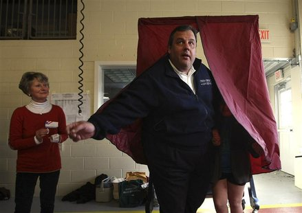 Poll worker Annie Barr watches as Governor Chris Christie exits the voting booth with his daughter Bridget, 8, at the Mendham Emergency Serv