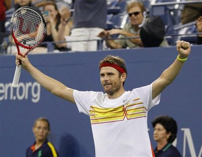 Mardy Fish of the U.S. celebrates defeating Gilles Simon of France during their match at the US Open men's singles tennis tournament in New