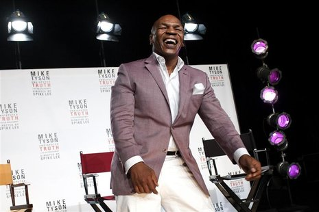 "Former heavyweight champion Mike Tyson laughs as he talks about the Broadway debut of his one-man show ""Mike Tyson: Undisputed Truth"" during"