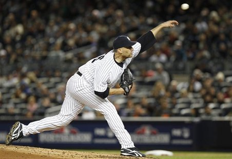 New York Yankees starter Andy Pettitte pitches to the Detroit Tigers during the second inning in Game 1 of their MLB ALCS playoff baseball s