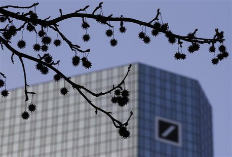 The logo of Germany's largest business bank, Deutsche Bank, is seen at the bank's headquarters behind twigs in Frankfurt January 31, 2012. R