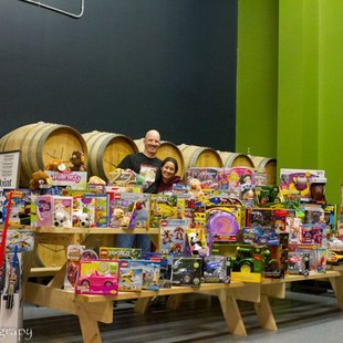 O'so Brewery's display of collected Toys For Tots with volunteers Marc & Katina Buttera