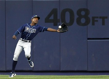 Tampa Bay Rays center fielder B.J. Upton fails to make a catch on an RBI single by New York Yankees Alex Rodriguez during the eighth inning
