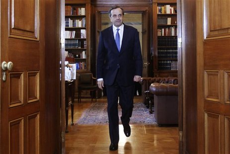 Greek Prime Minister Antonis Samaras arrives at the presidential palace for a meeting with Greek President Karolos Papoulias in Athens Novem