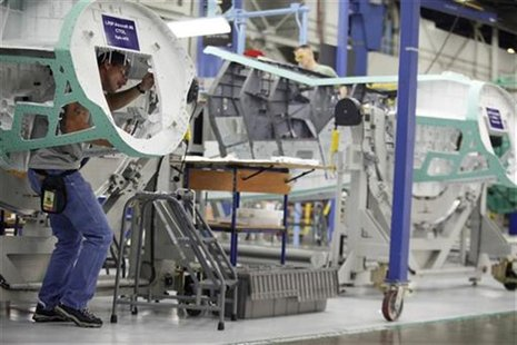 An assembly line worker works on Lockheed Martin's production plant for the F-35 fighter aircraft in Fort Worth, Texas August 31, 2009. REUT
