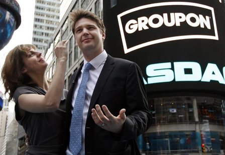 Groupon CEO Andrew Mason poses with his newly married wife, pop musician Jenny Gillespie, outside the Nasdaq Market following his company's