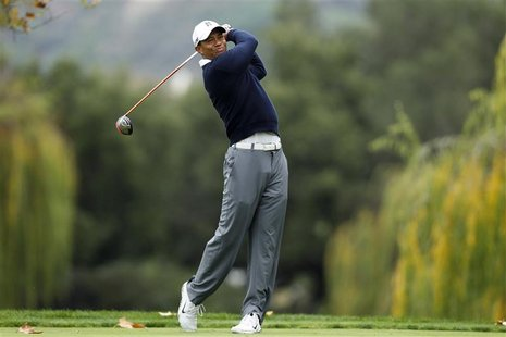 Tiger Woods of the U.S. tees off on the fifth hole during the first round of the World Challenge golf tournament in Thousand Oaks, Californi