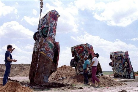 "One of ten Cadillac automobiles from the ""Cadillac Ranch"" art installation is lowered into the ground at its new home near Amarillo, Texas,"