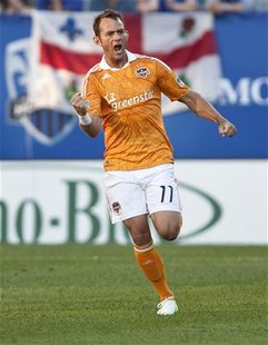 Houston Dynamo midfielder Brad Davis (11) celebrates after scoring against Montreal Impact during the first half of their MLS soccer match i