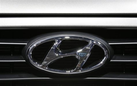 A Hyundai logo is seen on a car at the Paris Mondial de l'Automobile, September 28, 2012. The Paris auto show opens its doors to the public