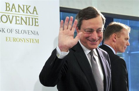 European Central Bank President Mario Draghi (C) waves after a news conference after the Governing Council Meeting of the European Central B