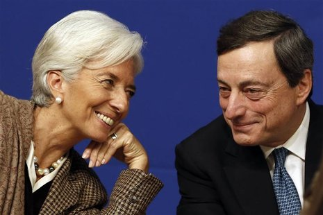 International Monetary Fund (IMF) Managing Director Christine Lagarde (L) and European Central Bank (ECB) President Mario Draghi attend the