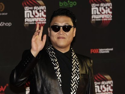 South Korean pop singer Psy poses on the red carpet as he attends the Mnet Asian Music Awards (MAMA) in Hong Kong November 30, 2012. REUTERS