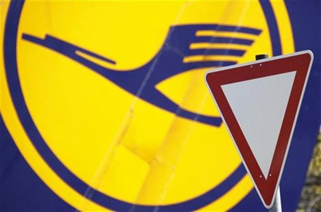 A yield traffic sign is pictured next to a Lufthansa logo at Frankfurt Airport April 18, 2010. REUTERS/Johannes Eisele