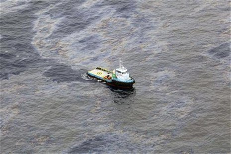 An aerial view is seen of oil that seeped off the coast of Rio de Janeiro, caused by a well drilled by Chevron at Frade, on the water in Cam