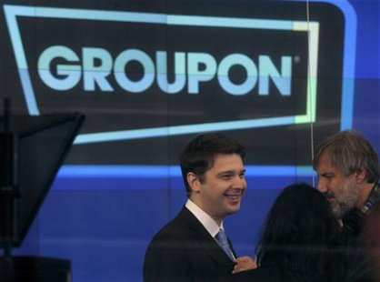 Groupon Chief Executive Andrew Mason (L) prepares for the opening bell ceremony celebrating his company's IPO at the Nasdaq Market in New Yo