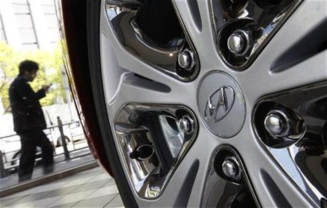 The logo of Hyundai Motor is seen on the wheel of a car at a Hyundai dealership in Seoul April 26, 2012. REUTERS/Kim Hong-Ji