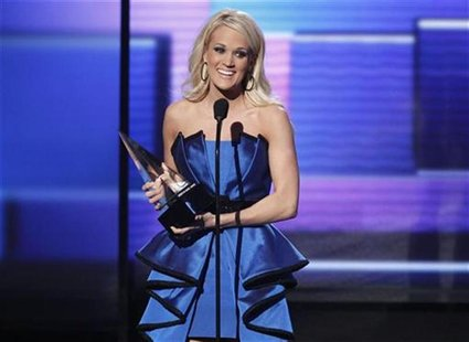 "Carrie Underwood accepts the award for favorite country album for ""Blown Away"" at the 40th American Music Awards in Los Angeles, California,"