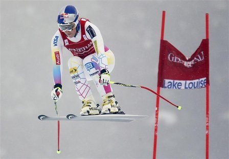 U.S. skier Lindsey Vonn speeds past a gate in the fog during the first Women's World Cup Downhill skiing race of the season in Lake Louise,